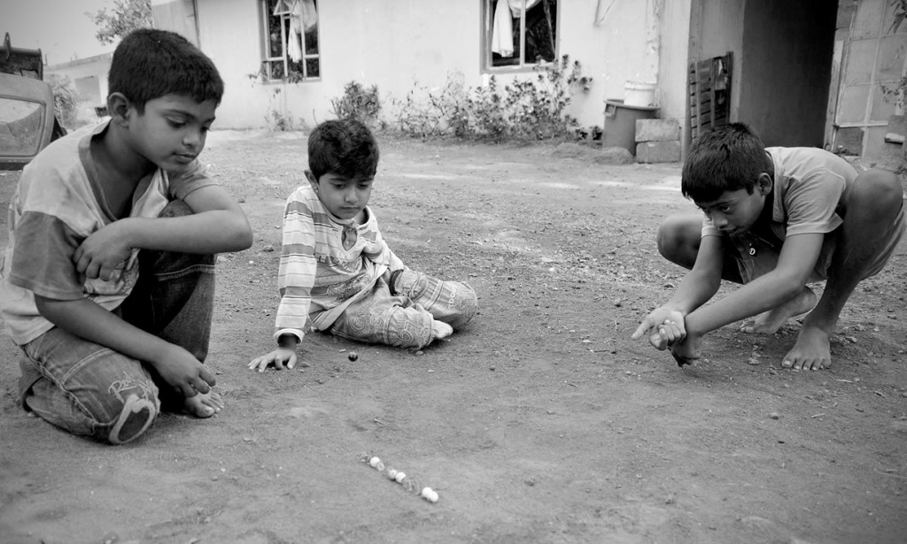 Kids Playing with Marbles 2014 Classic Toys Mauritius